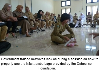 Government trained midwives look on during a session on how to properly use the infant ambu bags provided by the Osbourne Foundation.