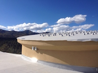 Solar panel attachments on roof of new nature center